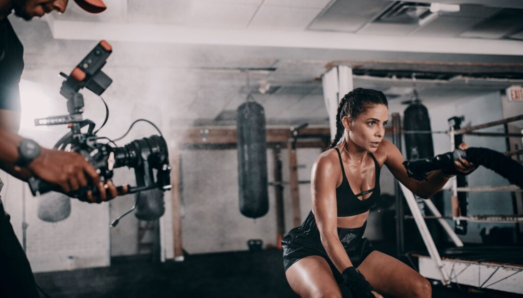 woman in gym with dumbbells