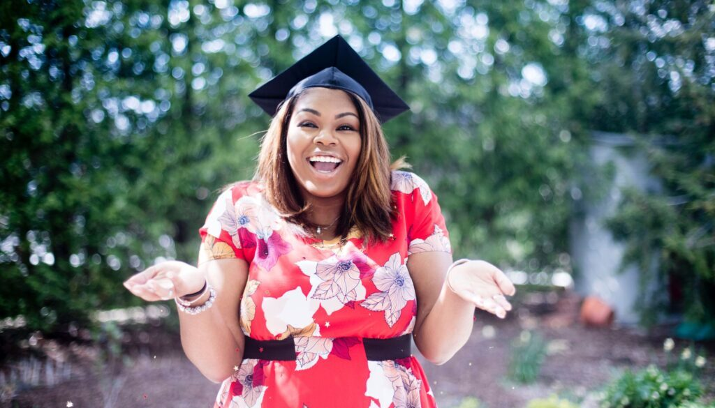 young woman graduate graduating question questioning happy what kind of person should I be Bible alert pray prayerful