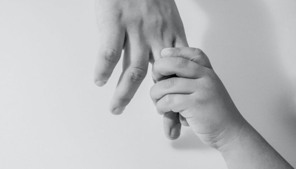 child holing an adult adult's hand