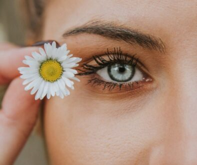 beautiful woman eye make up makeup with flower daisy