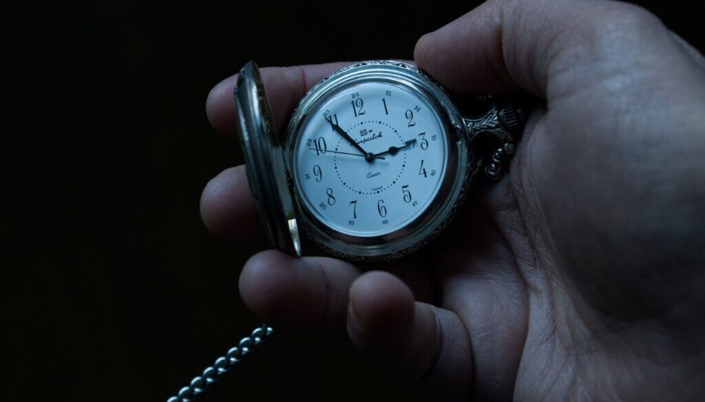 close up photo of a hand holding a stop watch stopwatch