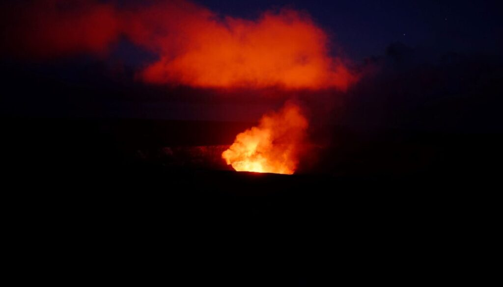 lava glowing at night from a fissure in the ground