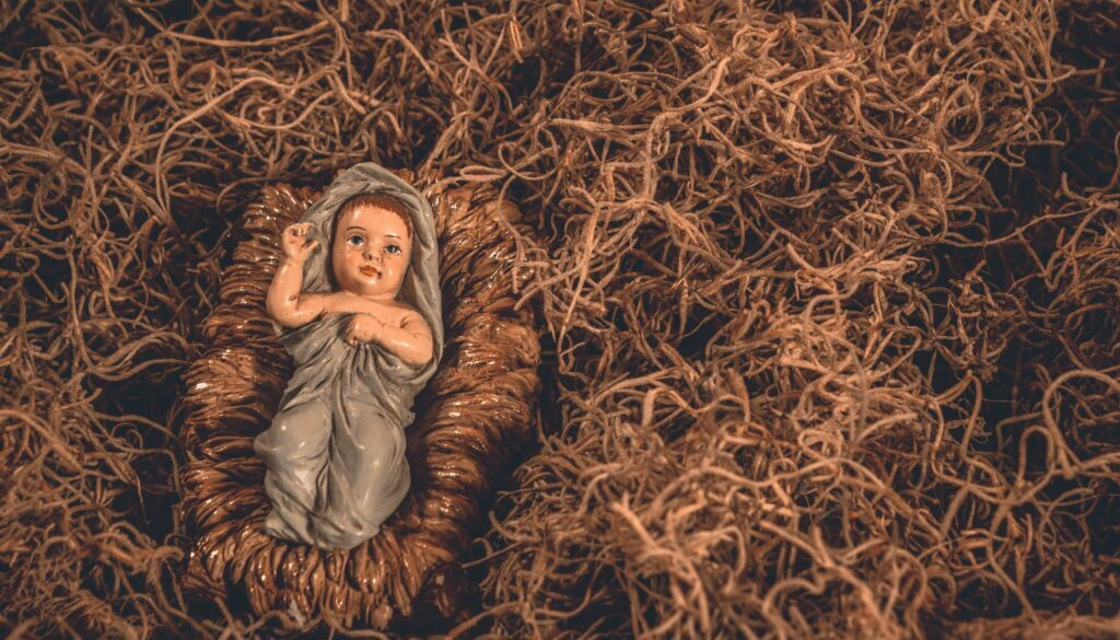 nativity figure of baby Jesus in the hay