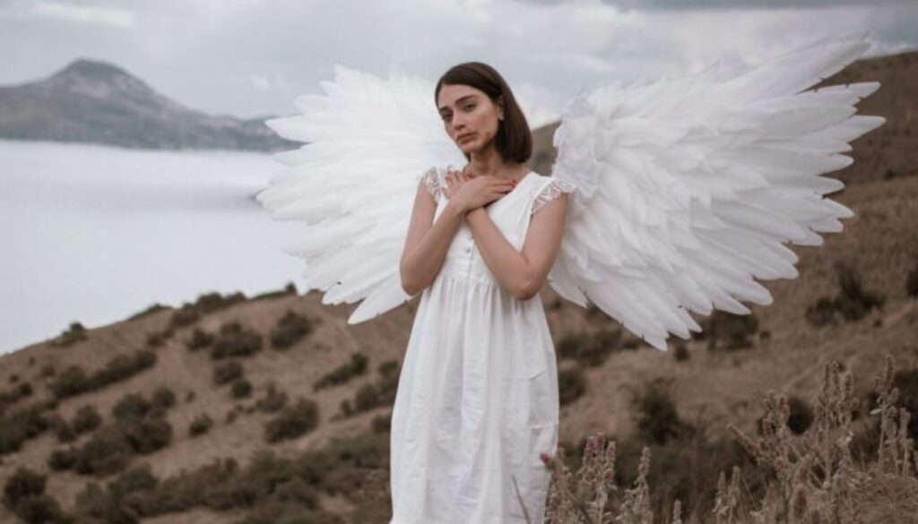 pretty young woman dressed like an angel