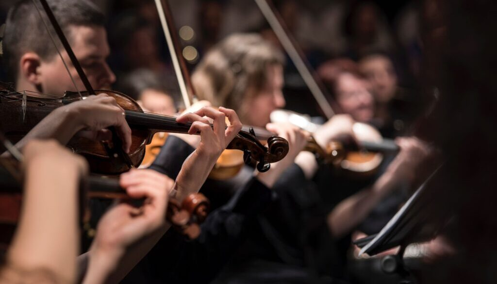 violinists playing in an orchestra