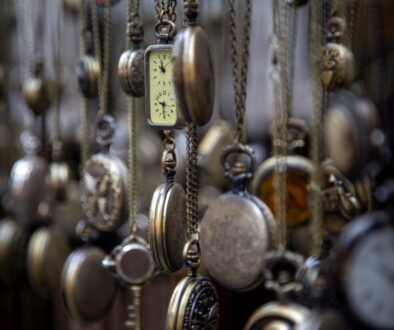 dozens of pocket watches hanging from chains