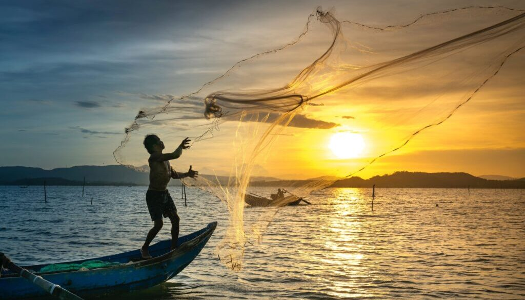fisherman casting a net
