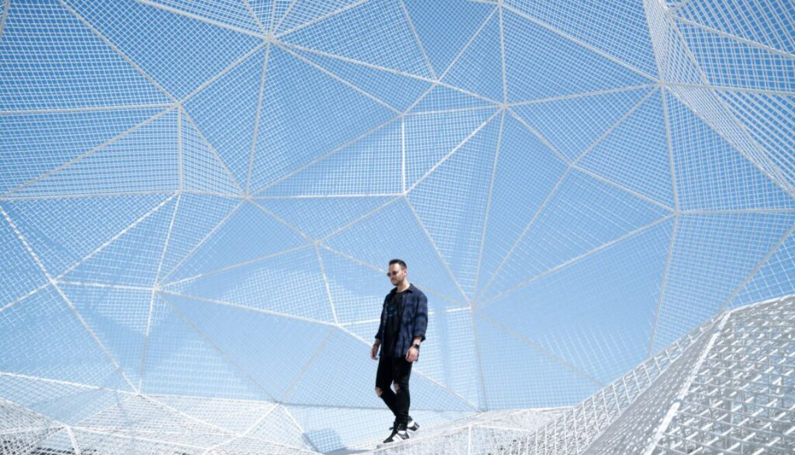 man who seems to be walking within a transparent geodesic dome
