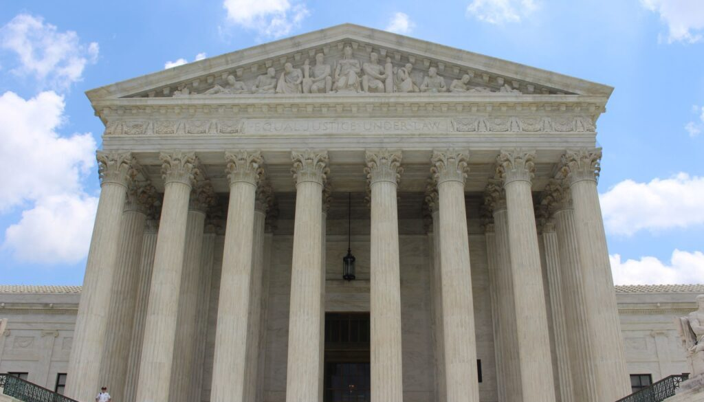 front view of the supreme court of the united states of america looming large