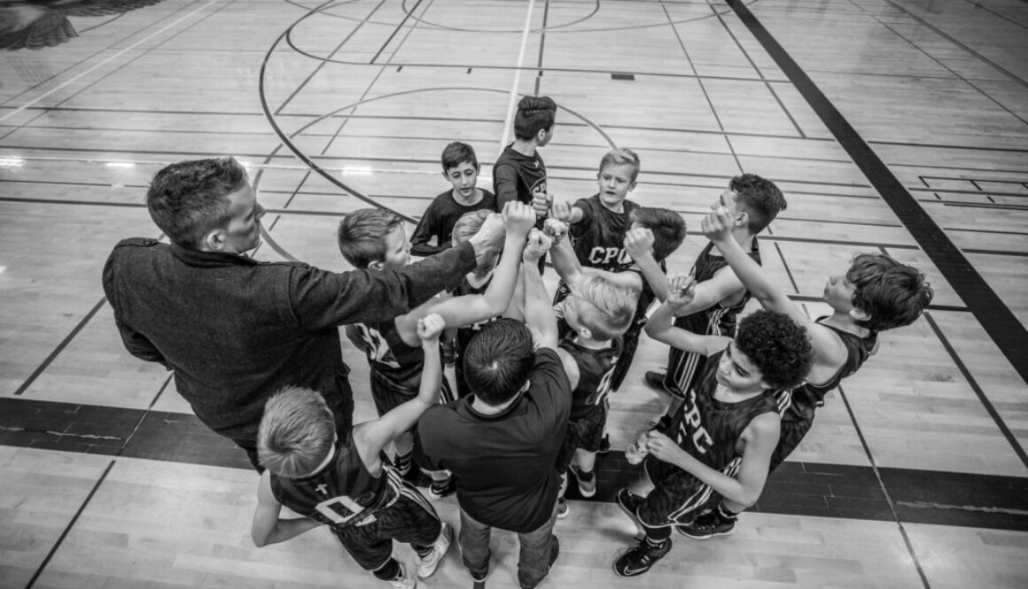 black and white photo of a boys basketball team